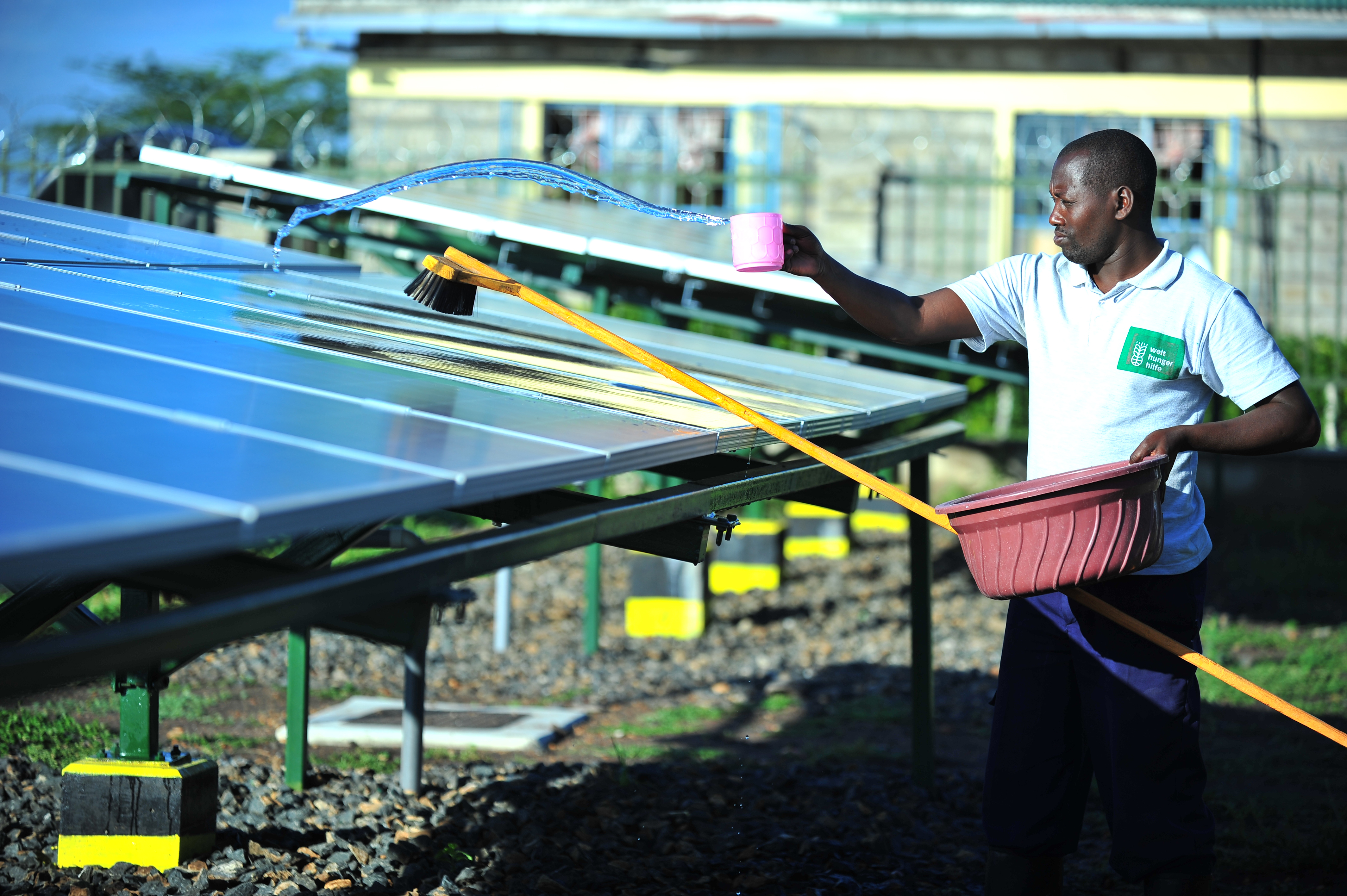 Silandoi Matikoi caretaker of Talek Solar Power Plant in Narok County, Kenya cleans the solar panels used to supply power to the residents of Talek town. Constructed with the help of the German government, the power plant will supply clean green power to the residents of Talek who are not connected to the National power grid
